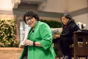 Supreme Court Justice Sonia Sotomayor holding her book Turning Pages