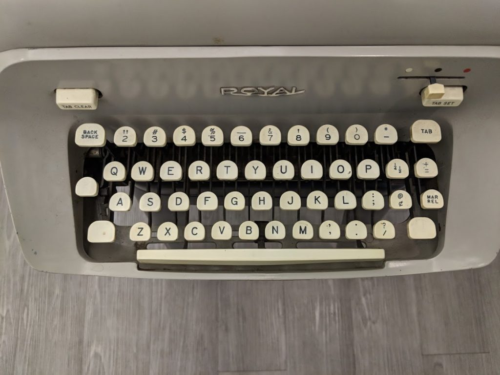 Top-down image of Hugh Hefner's Royal typewriter on display at the American Writers Museum