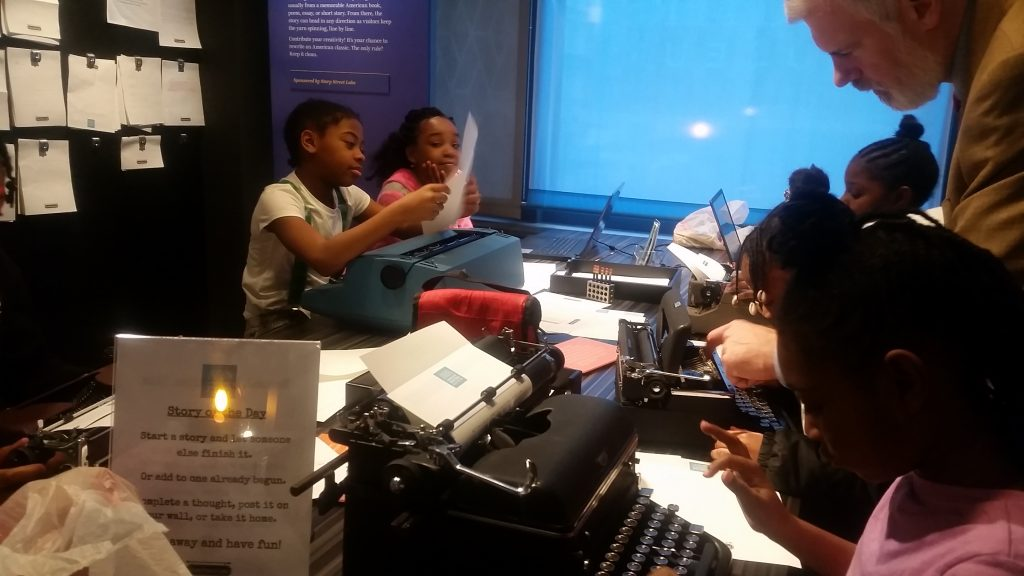 Students on a field trip at the American Writers Museum in Chicago learn how to write on typewriters