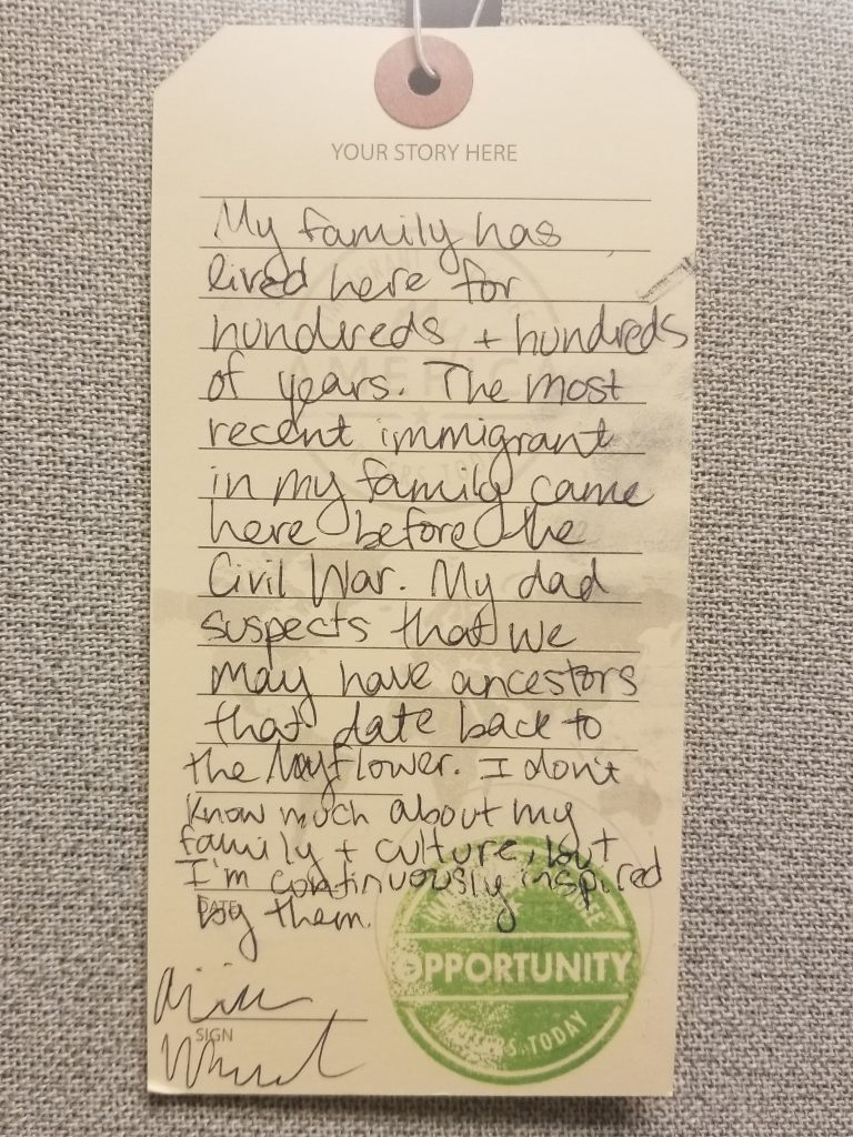 luggage tag sharing an immigration story written by a visitor to the My America: Immigrant and Refugee Writers Today exhibit at the American Writers Museum in Chicago