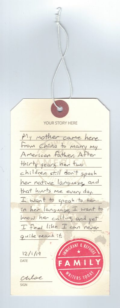 A luggage tag showing a visitor's immigration story at the American Writers Museum's newest exhibit, My America: Immigrant and Refugee Writers Today