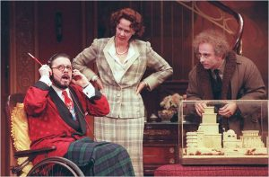 """Nathan Lane, Harriet Harris and Stephen DeRosa in """"The Man Who Came to Dinner"""" in 2000."""